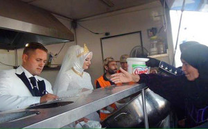 bride and groom serving refugees